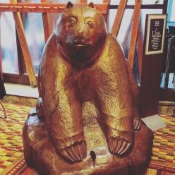 Adorable awkward bear statue.