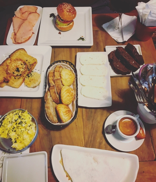 The best breakfast at Empório Jardim with tapioca, eggs, pão de leite, chocolate bread, and more.